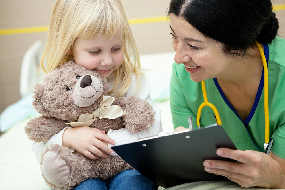 Please Read Carefully: doctor reads assent information to little girl