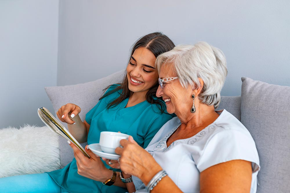 Please Read Carefully: Nurse and elderly lady read healthcare information together